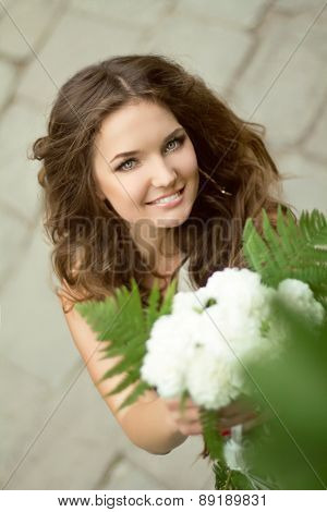 Beautiful Smiling Bride Close Up. Wedding Outdoor Portrait. Bridal Bouquet. Happy Day.
