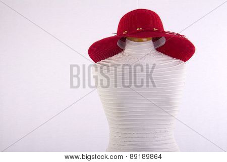 red summer hat on mannequin isolated on white background