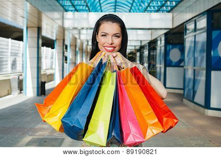 Beautiful Woman With Smile Holding Shopping Bags
