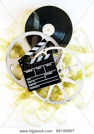 Movie Clapper On 35Mm Yellow Unrolled Film And Cinema Reels
