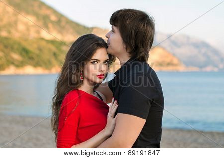 Attractive Young Couple Portrait, Romantic Lovers In Love At Beach Sunset.