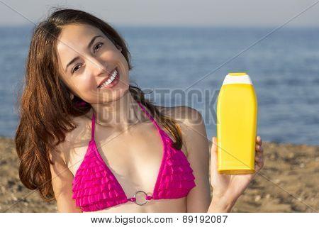 Attractive Woman Showing Sun Cream