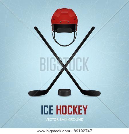 Ice hockey helmet, puck and crossed sticks.