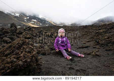Cranky Little Girl Resting On The Lava Fields Of Mount Etna
