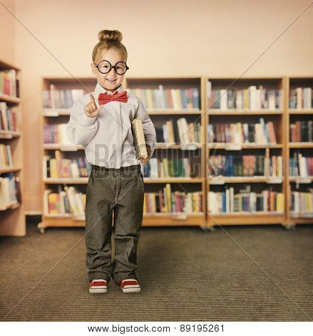 School Kid In Library, Child In Glasses With Book, Little Girl Student, Bookcase Shelves