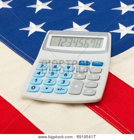 Calculator Over Usa Flag - Accounting Concept
