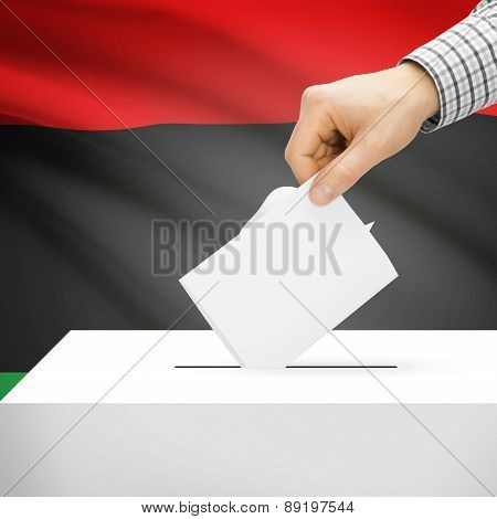 Voting Concept - Ballot Box With National Flag On Background - Libya