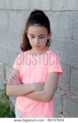 Angry preteen girl with pink t-shirt in the street