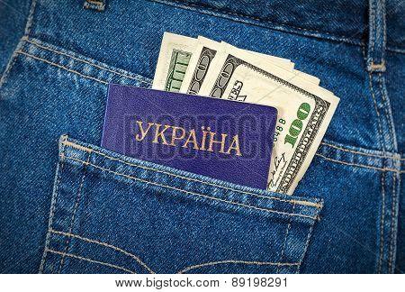 Ukrainian Passport And Dollar Bills In The Back Jeans Pocket