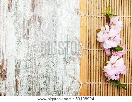 Sakura Branch On A Bamboo Mat