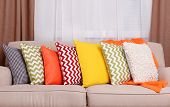 stock photo of lounge room  - Sofa with colorful pillows in room - JPG