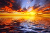 picture of fiery  - Fiery sunset over the sea in the tropics - JPG