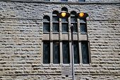 stock photo of illinois  - A lamppost in front of the stained glass windows of John - JPG