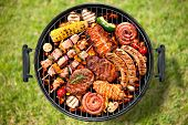 stock photo of barbecue grill  - Assorted delicious grilled meat with vegetable over the coals on a barbecue - JPG