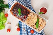 image of meatloaf  - Homemade ground meatloaf with ketchup and basil - JPG