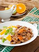 image of dessert plate  - Healthy dessert with muesli and fruit in a white plate on the table - JPG