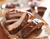 stock photo of spare  - grilled pork spare ribs in barbecue sauce on wooden cutting board - JPG