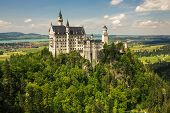 stock photo of bavarian alps  - Neuschwanstein Castle in the Bavarian Alps - JPG