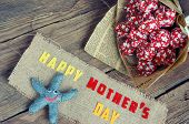 stock photo of i love you mom  - Happy mothers day with i love you mom message idea from colorful fabric starfish on wooden background beautiful flower abstract wooden texture mother - JPG