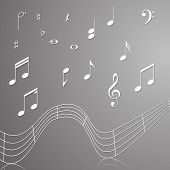 stock photo of clefs  - treble clef musical signs of paper with reflection on a gray background - JPG