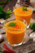 foto of lenten  - Delicious cream of pumpkin soup in a glass on wooden table - JPG