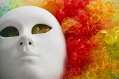 image of venice carnival  - colorful rainbow wig and venice carnival mask - JPG
