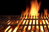 picture of flames  - Empty Flaming Charcoal Grill With Flames Of Fire On Black Background Closeup - JPG