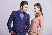 foto of she-male  - Handsome young fashion man looking at his lover while she is holding his arm - JPG