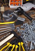 stock photo of triplets  - Set of different tools on wooden background - JPG