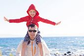 picture of cold-shoulder  - little boy sitting on his father - JPG