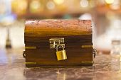 stock photo of treasure  - treasure box with lock used for tips waiter in restaurant - JPG