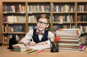 picture of book-shelf  - School Kid Studying in Library Child Writing Paper Copy Book in Classroom with Shelves - JPG
