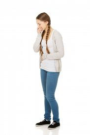 image of vomiting  - Sick teen woman about to vomit covering mouth - JPG