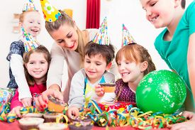 picture of birthday hat  - Children at birthday party grabbing muffins and cake - JPG