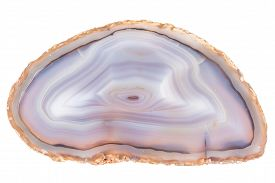 stock photo of agate  - Thin slice of agate geodes with concentric layers isolated over a white background - JPG