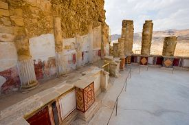 stock photo of masada  - Pilasters and columns plastered and painted with frescos at the lower terrace of the palace of king Herod on the rock masada - JPG