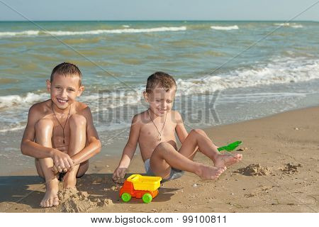 Happy  Children - Two Boys Having Fun On The Beach