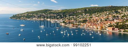 Panoramic aerial view of French Riviera coast at Villefranche-sur-Mer harbour and Cap de Nice with leisure boats anchored at Mediterranean sea