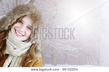 Beautiful young woman in fur hood of winter coat outside on sunny snowy day with copy space
