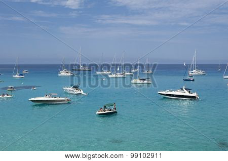 Many Boats Moored On The Blue And Green Sea