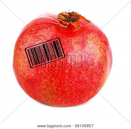 Juicy ripe pomegranate with barcode, isolated on white