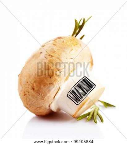 Fresh mushroom with barcode isolated on white