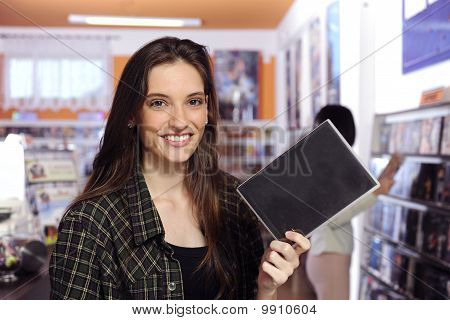 Happy Woman At The Video Rental Store