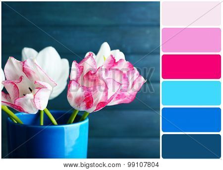 Beautiful tulips on wooden background and palette of colors