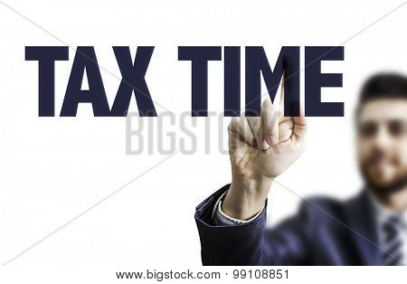 Business man pointing the text: Tax Time