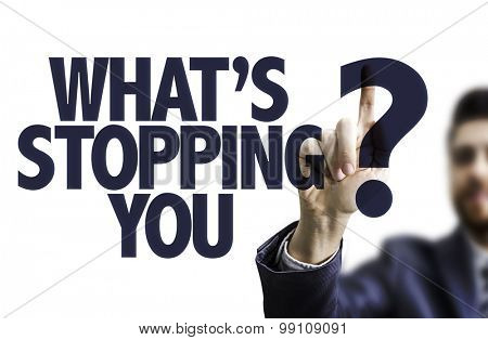 Business man pointing the text: Whats Stopping You?