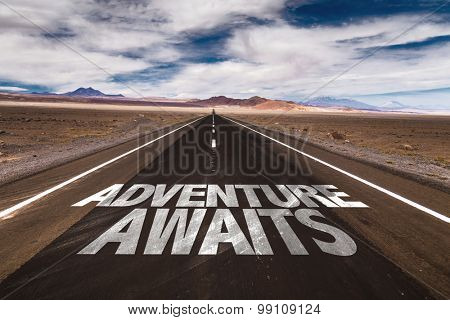 Adventure Awaits written on desert road