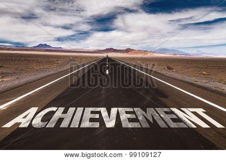 Achievement written on desert road