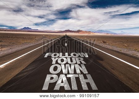 Follow Your Own Path written on desert road