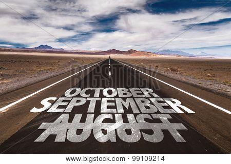 October September August written on desert road